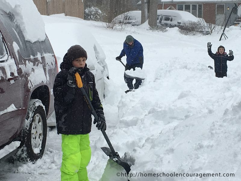 Snow Day. Kids Shoveling Snow for Fun.