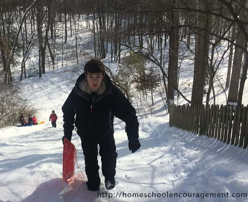 Climbing up the Snow Hill. Snow Day with kids.