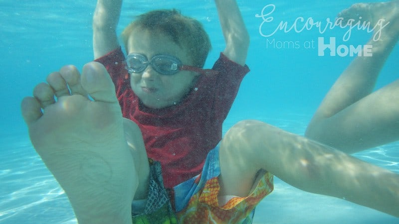 Swimming at pool. Boy at water under pool. Twenty tips for moms at the pool.
