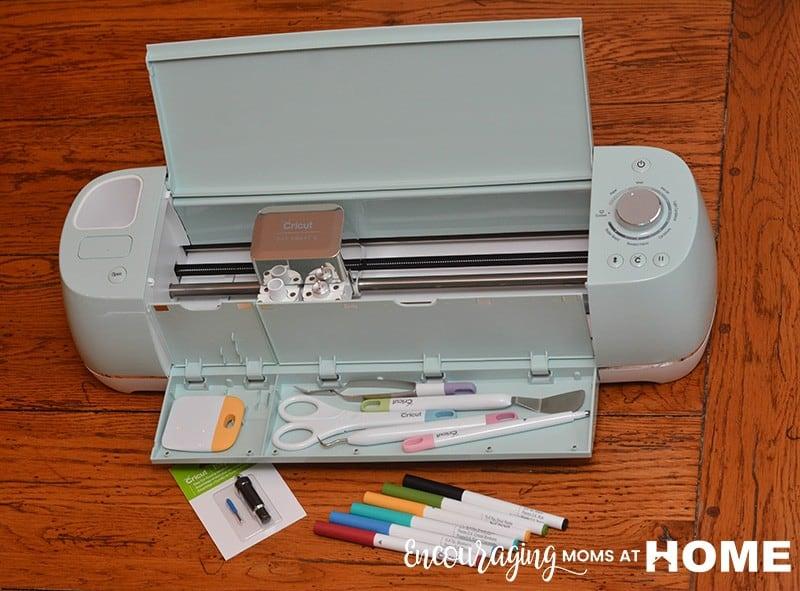 Circuit tools - weeder, scraper, tweezers, scissors, markers, replacement blades - shown with a Cricut Air Explore 2 machine