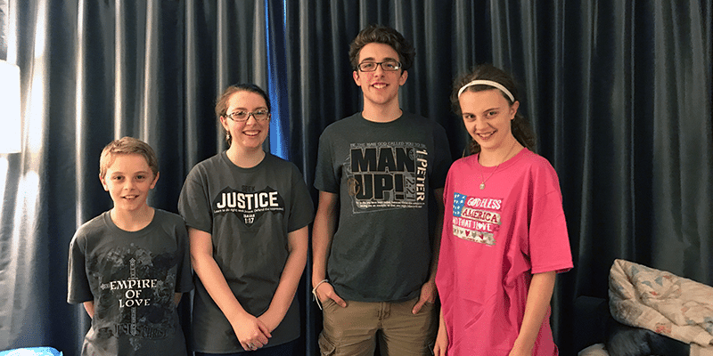 Great Homeschool Conventions 2017 - the kids model their new shirts from the fabulous vendor hall. So much fun!