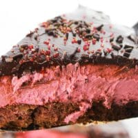 The Best Red Velvet Cheesecake with Chocolate Ganache for Valentine's Day