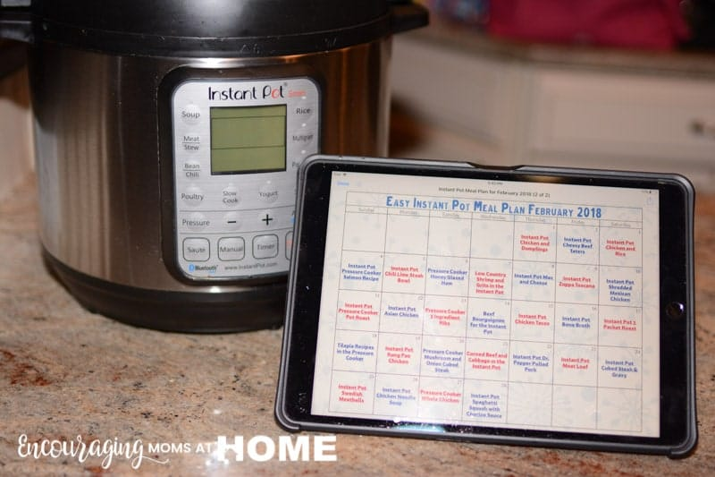 "Easy Instant Pot Meal Plan on Calendar displayed on iPad Pro 10.6"" in front of Instant Pot for easy viewing"