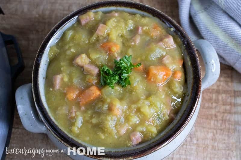 Split Pea and Ham Soup in a rustic Bowl on the counter.