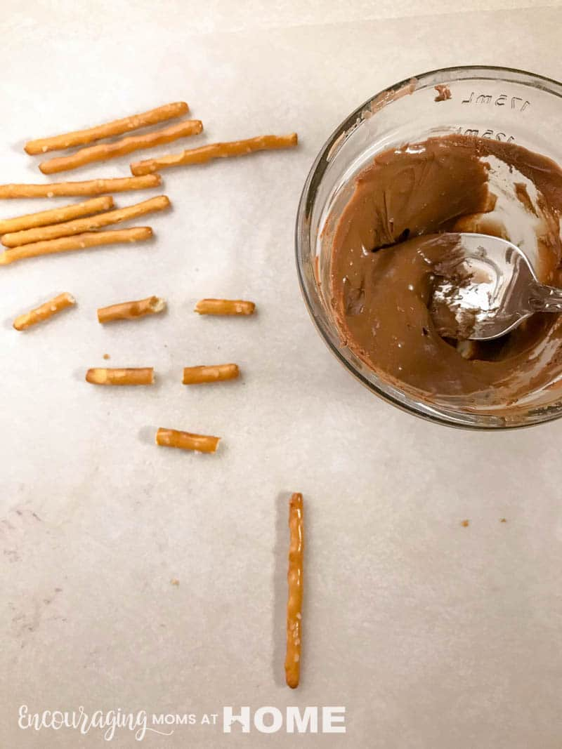 pretzels and melted chocolate for making crosses