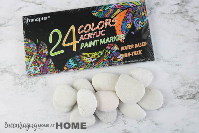 supplies to make Easter painted rocks. Pictured: markers and flat blank rocks.